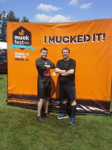 Our Boston MuckFest MS, a mud obstacle 5K fun run, with his trainer.