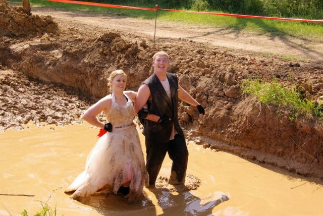 Bride and groom in wedding costume at MuckFest MS St. Louis