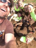 MuckFest MS Emcee Al taking a mucky selfie with participants at MuckFest MS Twin Cities 2014