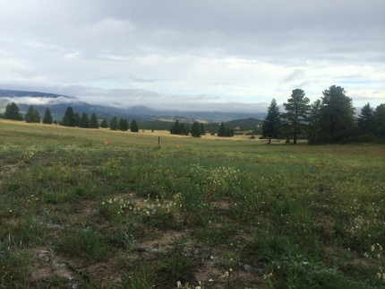 Sneak preview at MuckFest MS Denver setup. Rocky Mountains in background.